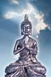 Metallic buddha on blue sky background