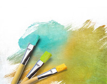 Artist Brushes With A Half Finished Painted Canvas
