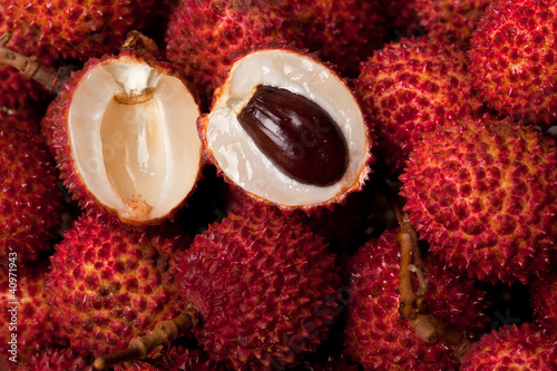 Halved lychee amid a pile of lychees
