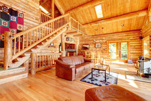 Luxury Log Cabin Living Room With Leather Sofa.