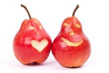 Two Red Pears With Eyes And Mouth
