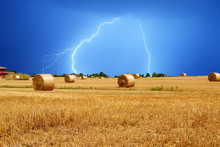 Lightning Over Bales Of Hay In...