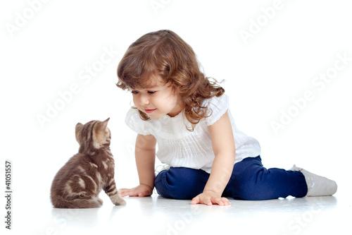 Vászonkép Funny child sitting on floor. Scottish kitten looking at girl.