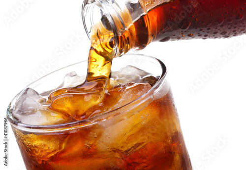 Fotografía Cola is pouring into glass