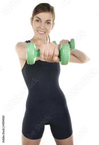 Fototapeta młoda dziewczyna ćwicząca ciężarkami obraz