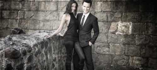 192fc37004dc5 Conceptual portrait of a young couple in elegant evening dresses ...