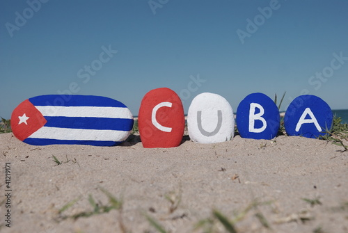 Cuba flag and name of the nation on pebbles Wallpaper Mural