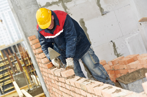 Fotografia, Obraz  construction mason worker bricklayer