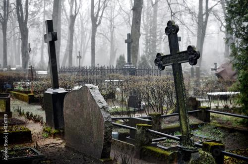 Foto op Canvas Begraafplaats cross in fog at the cemetary