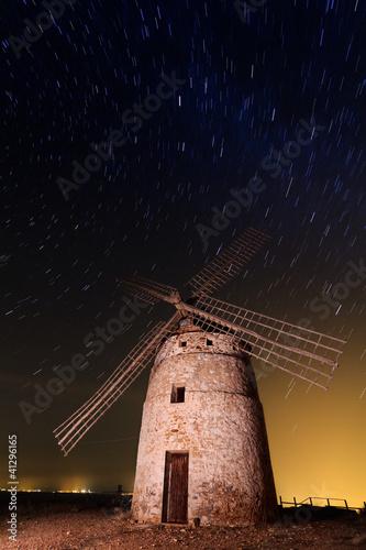 Fotobehang Molens Typical windmill surrounded of stars in Castilla la Mancha, Spai