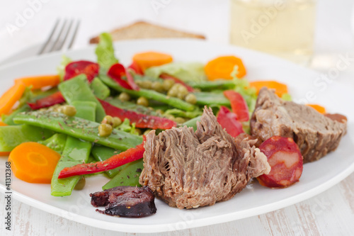Papiers peints Steakhouse boiled meat with sausages and vegetable salad