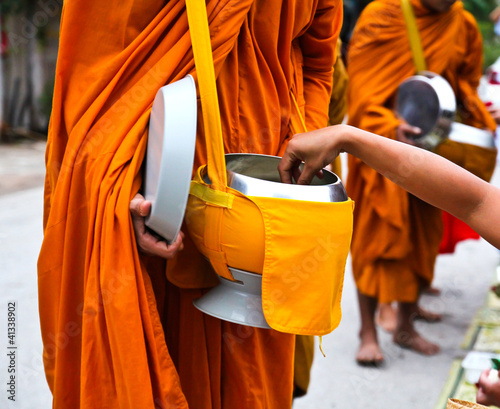 Fotografija Offer food to monk on early morning