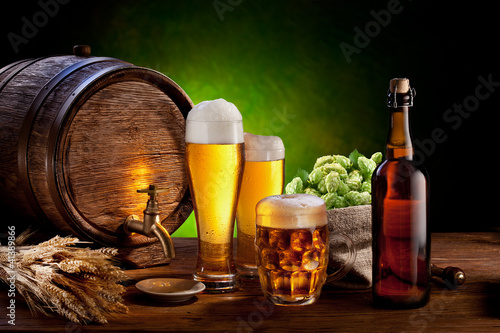 Beer barrel with beer glasses on a wooden table. - 41389866