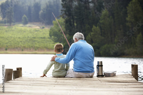 Printed kitchen splashbacks Fishing Senior man fishing with grandson