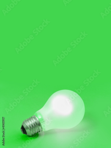 Lighting Lamp On Green Background This Stock Photo And