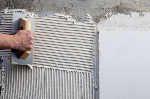 Photo  construction notched trowel with white cement