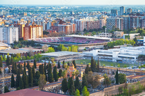 Láminas  view on  cemetery and fields of football stadium in Barcelona