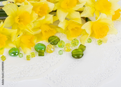 Garden Poster Narcissus Beautiful spring yellow flowers and colorful stones