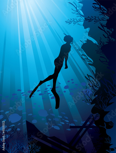 Silhouette of freediver in sea Wall mural