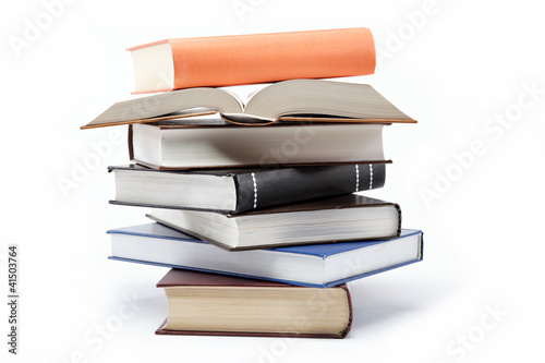 Stampa su Tela A stack of books on a white background.