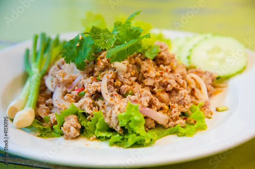 Larb chicken salad.Thai food with chicken, lime, chili, herbs Wallpaper Mural