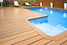 Blue Swimming Pool With  Wood Flooring-Piscina Madera