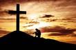 Leinwandbild Motiv Man sitting desperately under the cross