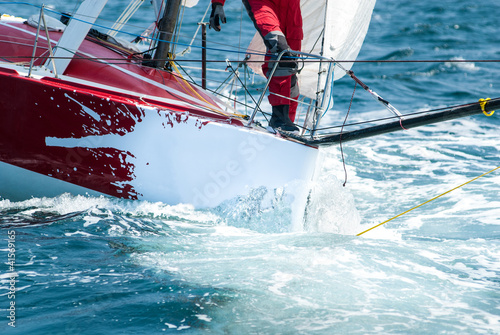 Voile skipper on bow at regatta