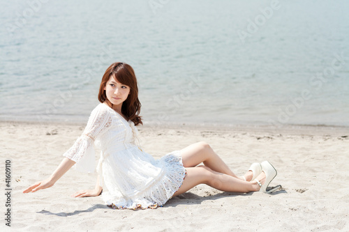 Deurstickers Ontspanning Beautiful young woman on beach summer holiday. Portrait of asian