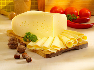 Fototapeta Ararangement with appetizing cheese on the kitchen table.