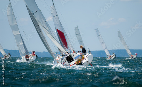 Poster Zeilen group of yacht sailing at regatta