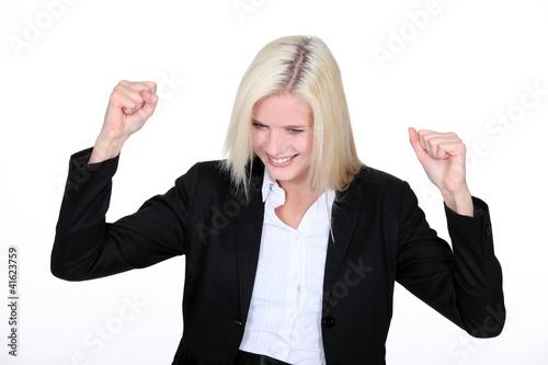 Fotografia  Blond businesswoman, celebrating