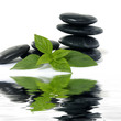 Reflection for stack black stones with bamboo