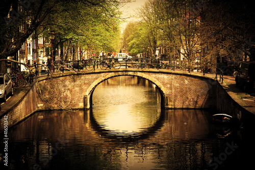 Amsterdam. Romantic bridge over canal. - 41650342