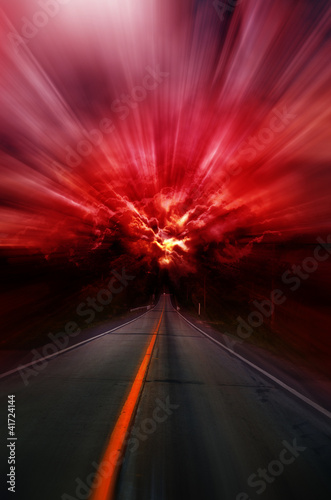 Photo  Blurred asphalt road and red bloody blurred sky