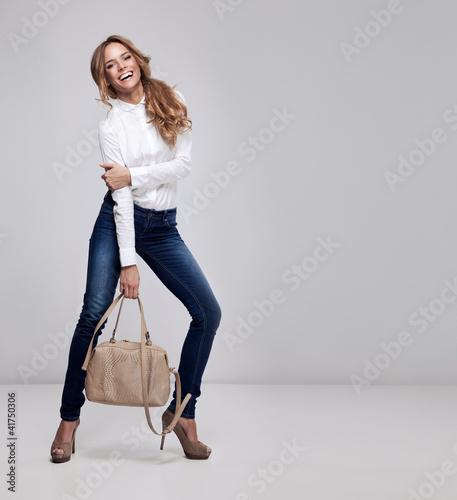 Obraz Young happy woman on a grey background - fototapety do salonu