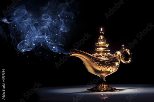 Fotografia  Magic Aladdin's Genie lamp on black with smoke