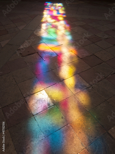 Fotografie, Obraz Reflection of stained glass on the stone floor in church