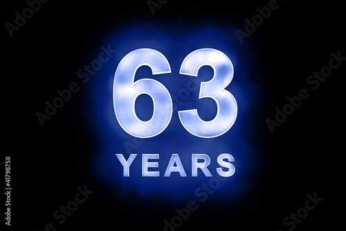 Fotografia  63 Years in glowing white numbers on blue