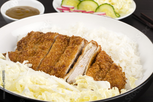 Photo  Tonkatsu served with shredded cabbage and steamed rice.