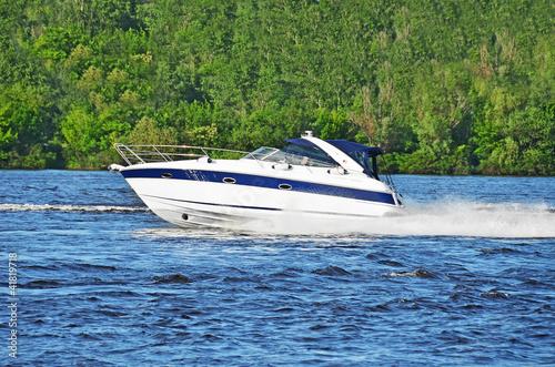 Garden Poster Water Motor sports Motorboat on the Dnieper river, Kiev, Ukraine