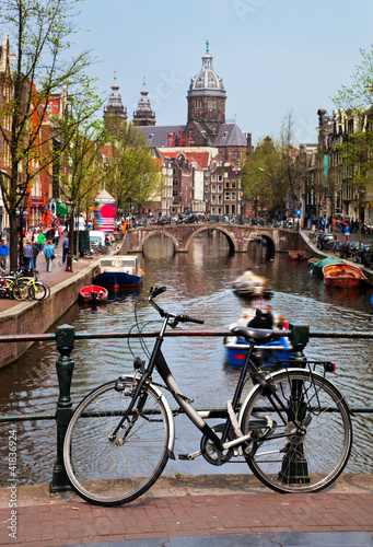 Photo  Amsterdam old town canal, boats. Netherlands