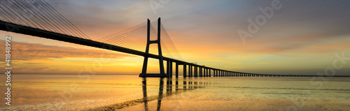 Foto op Canvas Bruggen Panorama image of the Vasco da Gama bridge in Lisbon