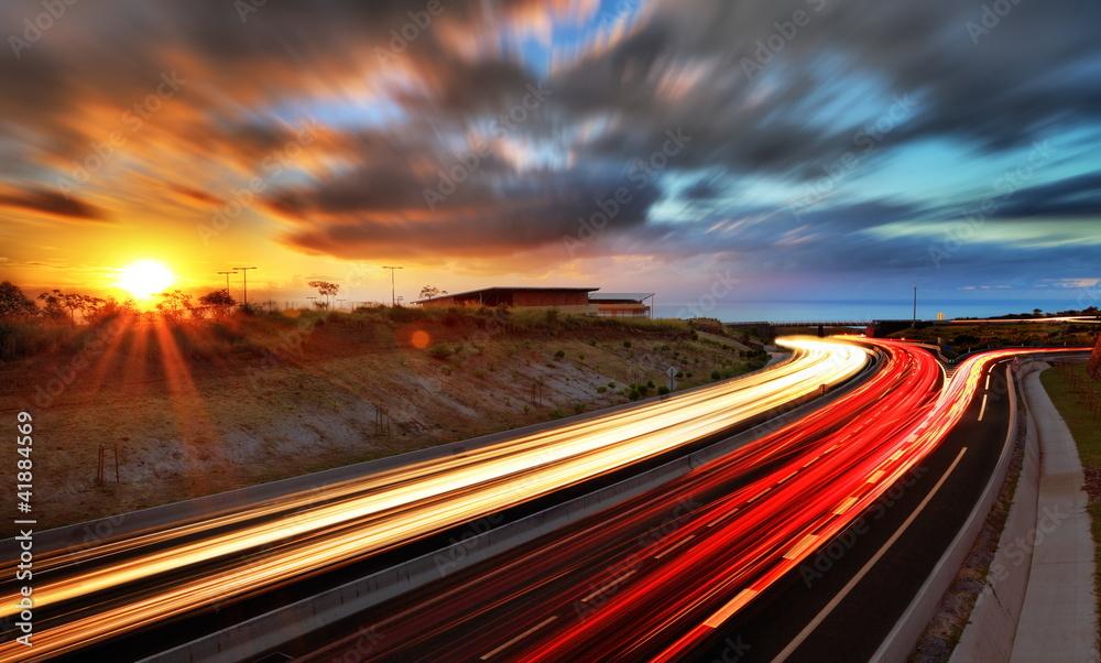 Fototapeta Coucher de soleil sur la route des Tamarins, La Réunion.