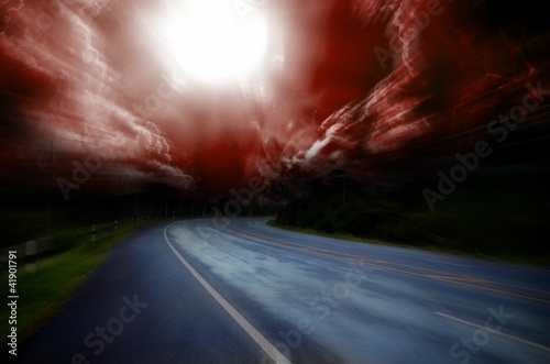 фотография Blurred asphalt road and red bloody blurred sky
