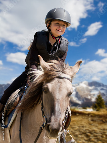 Poster Equitation Horse riding - portrait of lovely equestrian on a horse
