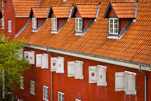 Photo  Red brick building with red roof in Kastellet Citadel