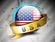 Glossy American Flag globe with golden ribbon on grey