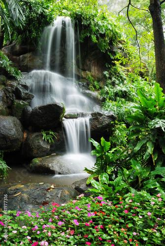 Beautiful waterfall in the garden © Goldsaintphoto