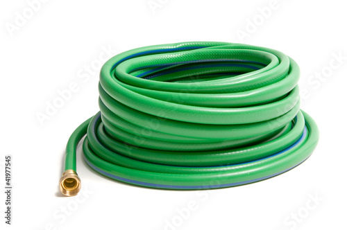 Fotografie, Obraz  Rolled up garden hose isolated on white